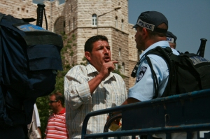 An Arab man is denied entry to the old city of Jerusalem on Friday amid a high-security alert.